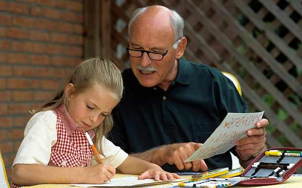 portrait of grandpa and grandschild working at home lessons