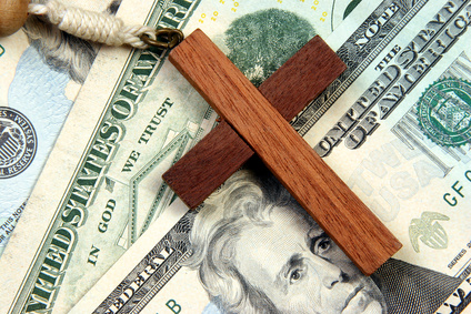 Cross-laying-on-Money-Fotolia_450504_XS.jpg