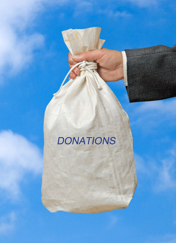 hand_with_bag_of_donations.jpg