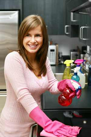 woman-cleaning-kitchen-grease