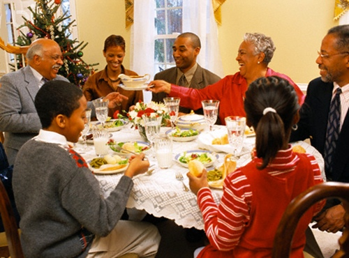 Family Enjoying Christmas Dinner --- Image by © Ariel Skelley/CORBIS