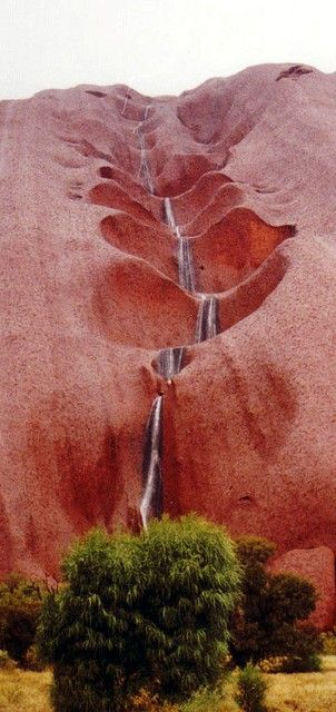 Water cascading off the side of Uluru